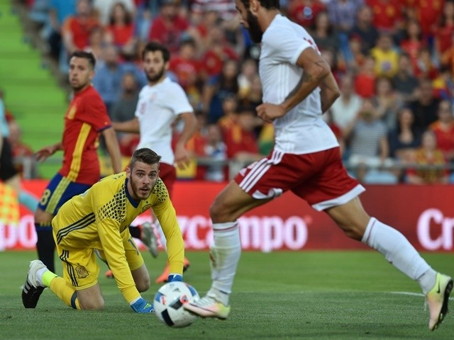 Georgia's Tornike Okriashvili scores past Spain's David de Gea during an international friendly on June 7, 2016