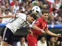 Jonas Hector and Lukasz Piszczek in action during the Euro 2016 Group C match between Germany and Poland on July 16, 2016