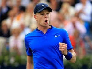 Kyle Edmund celebrates winning a point during his first-round match against Gilles Simon at Queen's on June 15, 2016