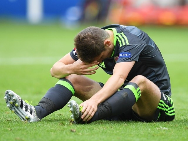 Ben Davies shows his dejection after England equalise during the Euro 2016 Group B game between England and Wales on June 16, 2016