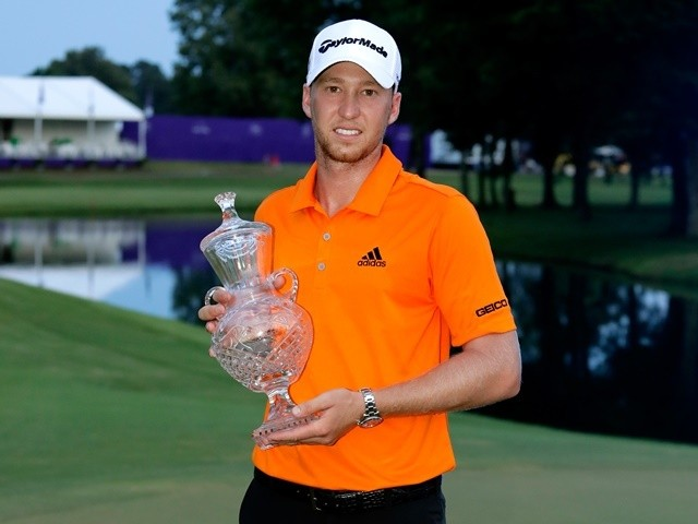 Daniel Berger celebrates with the trophy after winning the FedEx St Jude Classic during the final round at TPC Southwind on June 12, 2016