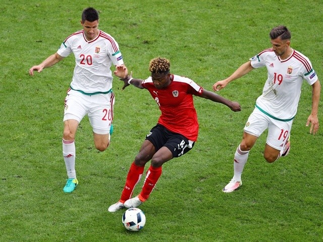 David Alaba, Richard Guzmics and Tamas Priskin in action during the Euro 2016 Group F game between Austria and Hungary on June 14, 2016