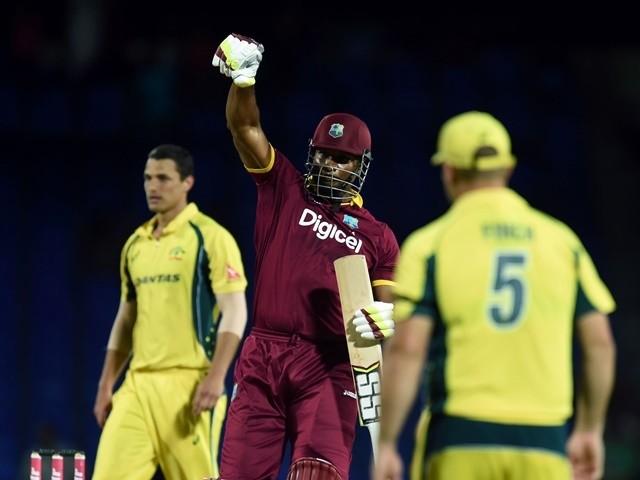 West Indies cricketer Kieron Pollard celebrates their victory over Australia on June 13, 2016