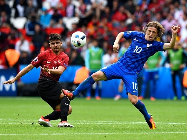 Ozan Tufan and Luka Modric during the Euro 2016 Group D game between Turkey and Croatia on June 12, 2016