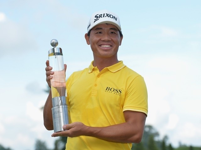 Ashun Wu of China celebrates with the trophy after winning the 2016 Lyoness Open on June 12, 2016
