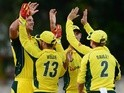 Nathan Coulter-Nile of Australia celebrate the wicket of Andre Fletcher of the West Indies with his team mates during the Tri-Nation Series One-day International (ODI) Final between West Indies and Australia at the Kensington Oval on June 26, 2016