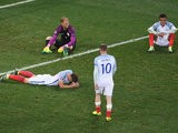 Wayne Rooney (2nd R) of England walks to console Gary Cahill (1st L), Joe Hart (2nd L) and Dele Alli (1st R) after their defeat in the UEFA EURO 2016 round of 16 match between England and Iceland at Allianz Riviera Stadium on June 27, 2016 in Nice, France