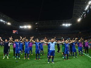 Iceland players celebrate their team's 2-1 win in the UEFA EURO 2016 round of 16 match between England and Iceland at Allianz Riviera Stadium on June 27, 2016 in Nice, France