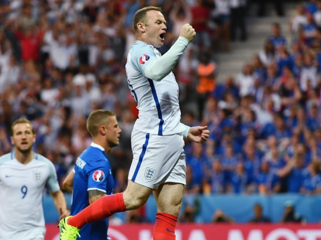 Wayne Rooney of England celebrates scoring the opening goal during the UEFA EURO 2016 round of 16 match between England and Iceland at Allianz Riviera Stadium on June 27, 2016 in Nice, France