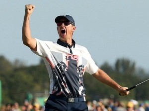 Justin Rose celebrates winning Olympic gold in Rio on August 14, 2016
