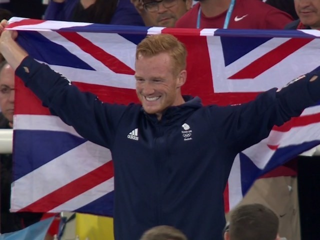 Greg Rutherford celebrates after winning Olympic bronze on August 13, 2016