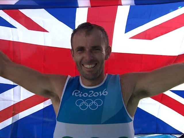 Nick Dempsey celebrates winning Olympic silver in Rio on August 14, 2016