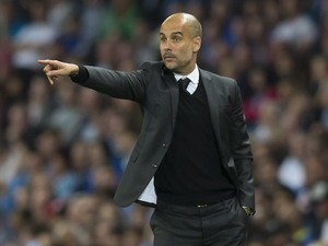 Manchester City manager Pep Guardiola gives instructions on August 24, 2016