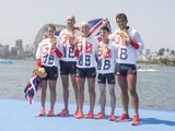 ParalympicsGB's LTA mixed coxed four team celebrate with their gold medal on September 11, 2016