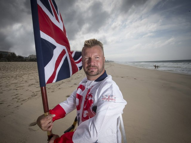 ParalympicGB flagbearer Lee Pearson bearing the flag of GB
