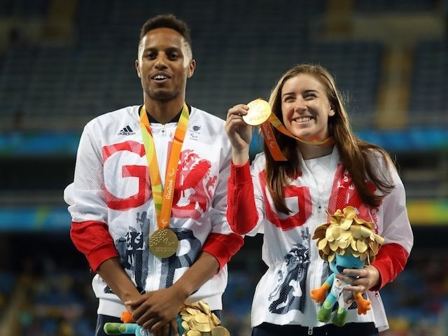 Libby Clegg celebrates with her gold medal after winning the women's T11 100m final at the Paralympic Games in Rio de Janeiro on September 9, 2016