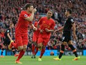 Liverpool's James Milner celebrates after scoring during the Premier League clash between Liverpool and Hull City at Anfield on September 24, 2016