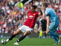 Manchester United striker Zlatan Ibrahimovic has a shot during his side's Premier League clash with Stoke City at Old Trafford on October 2, 2016