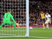 Theo Walcott scores his second during the Champions League game between Arsenal and Basel on September 28, 2016