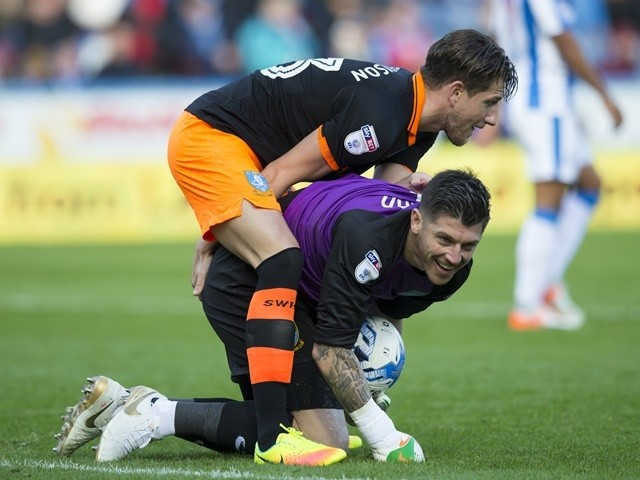 Sheffield Wednesday goalkeeper Keiren Westwood and teammate Sam Hutchinson forget themselves during the Championship match against Huddersfield Town on October 16, 2016