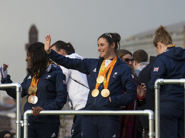 Dame Sarah Storey waves as Great Britain's Olympic and Paralympic athletes parade through Manchester to celebrate their winning performances at Rio 2016 in Manchester on October 17, 2016
