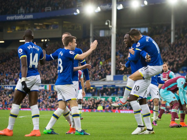 Everton striker Romelu Lukaku celebrates with teammates after scoring in their Premier League clash with West Ham United at Goodison Park on October 30, 2016