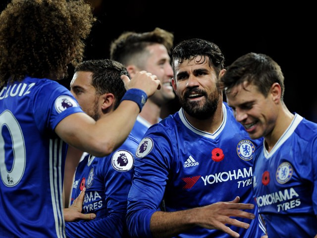 Diego Costa celebrates with Chelsea teammates after scoring during his side's victory over Everton at Stamford Bridge on November 5, 2016