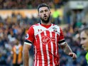 Southampton striker Charlie Austin in action during his side's Premier League clash with Hull City at the KCOM Stadium on November 6, 2016