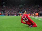 Liverpool midfielder Emre Can celebrates scoring during his side's Premier League clash with Watford at Anfield on November 6, 2016