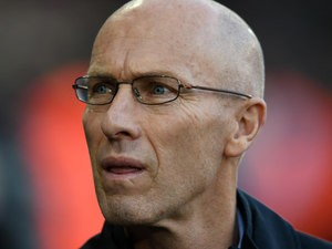 Swansea City manager Bob Bradley watches on from the touchline during his side's Premier League clash with Manchester United at the Liberty Stadium on November 6, 2016