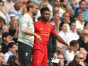 Liverpool manager Jurgen Klopp talks to striker Daniel Sturridge on the touchline during his side's Premier League clash with Tottenham Hotspur at White Hart Lane on August 27, 2016