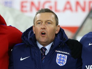Interim England Under-21s manager Aidy Boothroyd sings the national anthem before his side's friendly against Italy Under-21s at St Mary's Stadium on November 10, 2016