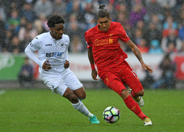 Swansea City midfielder Leroy Fer chases Liverpool's Roberto Firmino during the Premier League clash between the two sides on October 1, 2016