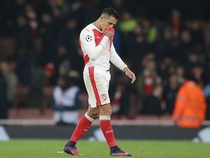 Alexis Sanchez reacts at the end of the Champions League game between Arsenal and PSG on November 23, 2016