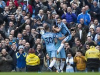 Jesus Navas celebrates with teammates after a Gary Cahill own goal during the Premier League game between Manchester City and Chelsea on December 3, 2016