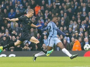 Kelechi Iheanacho scores with Jozo Simunovic in pursuit during the Champions League game between Manchester City and Celtic on December 6, 2016