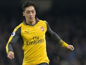 Mesut Ozil in action during the Premier League game between Manchester City and Arsenal on December 18, 2016