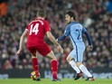 David Silva goes up against Jordan Henderson during the Premier League game between Liverpool and Manchester City on December 31, 2016