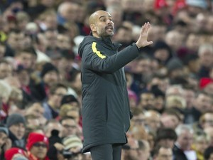 Pep Guardiola gives instructions during the Premier League game between Liverpool and Manchester City on December 31, 2016