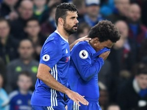 Willian celebrates scoring (apparently) with Diego Costa during the Premier League game between Chelsea and Stoke City on December 31, 2016