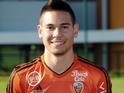 Smiling Lorient defender Raphael Guerreiro poses for his team portrait on November 2, 2015