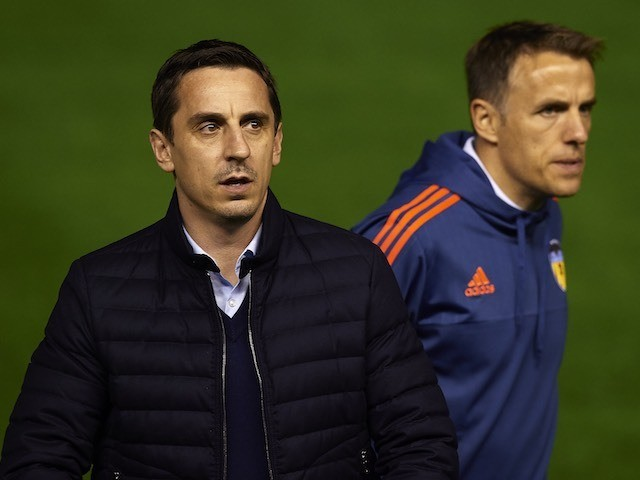 "Gary Neville and Phil Neville - aka ""The Nevilles"" - appear prior to the game between Valencia and Real Madrid on January 3, 2016"