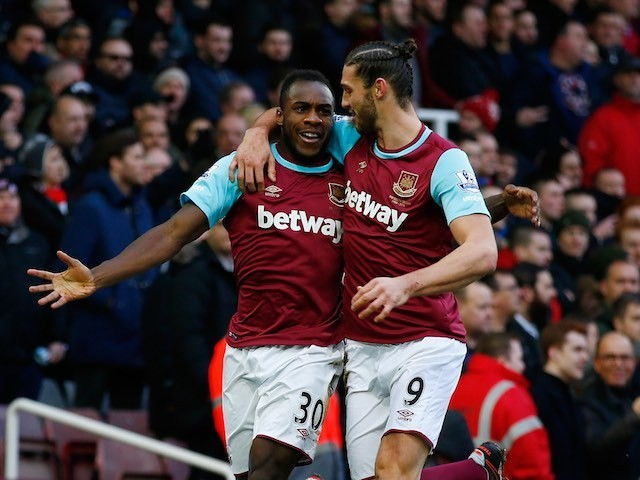 Michail Antonio celebrates with Andy Carroll during the game between West Ham and Liverpool on January 2, 2016