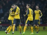 Aaron Ramsey celebrates with teammates after scoring during the FA Cup game between Preston North End and Arsenal on January 7, 2017