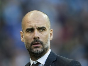 Pep Guardiola watches on during the Premier League game between Manchester City and Burnley on January 2, 2017