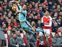 Gabriel Paulista and Ashley Barnes in action during the Premier League game between Arsenal and Burnley on January 22, 2017