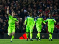 Liverpool's James Milner celebrates after scoring during his side's Premier League clash with Manchester United at Old Trafford on January 15, 2017