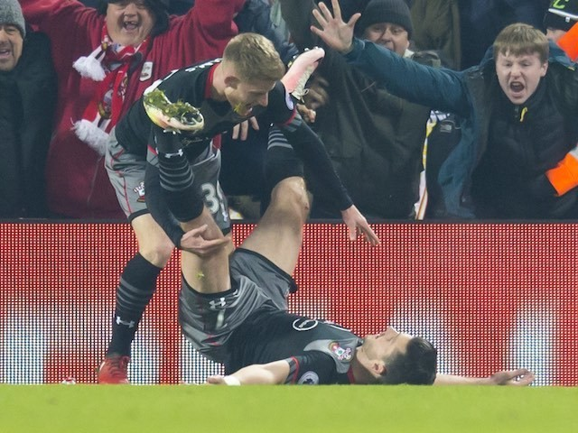 Shane Long celebrates scoring with Josh Sims during the EFL Cup semi-final between Liverpool and Southampton on January 25, 2017