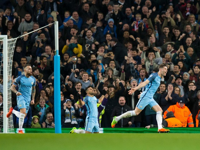Manchester City defender John Stones celebrates after scoring during the Champions League last 16 first leg against AS Monaco at the Etihad Stadium on February 21, 2017