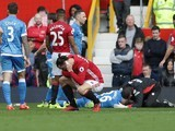 Zlatan Ibrahimovic holds his ear after a clash with Tyrone Mings during the Premier League game between Manchester United and Bournemouth on March 4, 2017